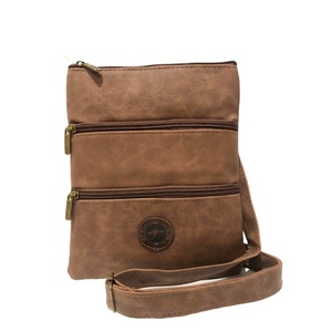 BROWN SUEDE THREE ZIPPER SLING BAG